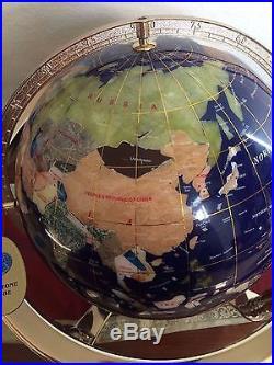 Globe with semi precious stones